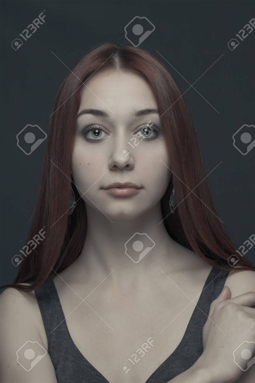 portrait of young girl over grey background Stock Photo - 12704919