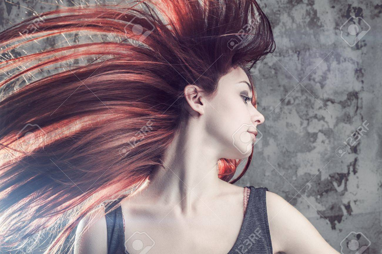 girl with flying hair over grunge background Stock Photo - 15322142