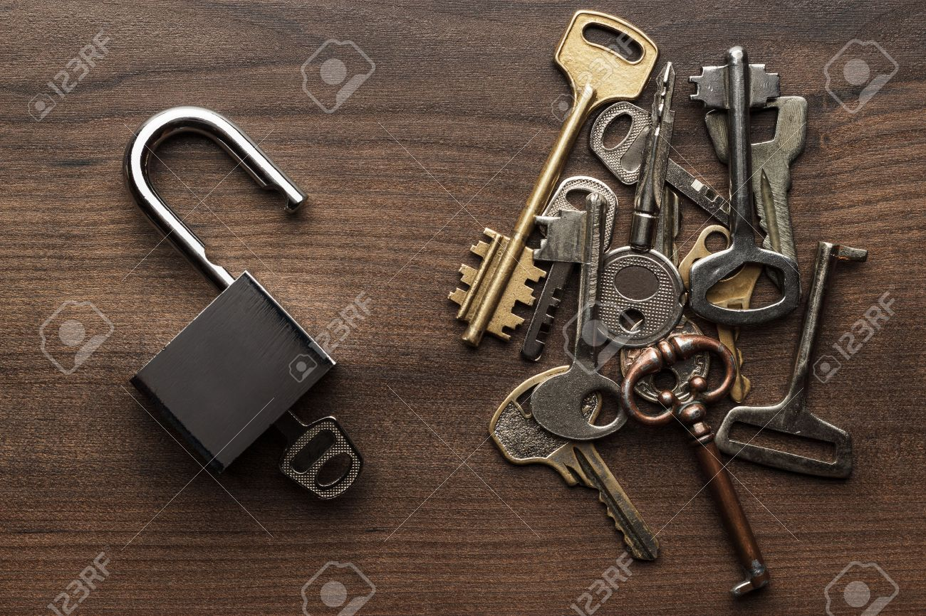 opened check-lock and different keys on wooden background concept - 45552890