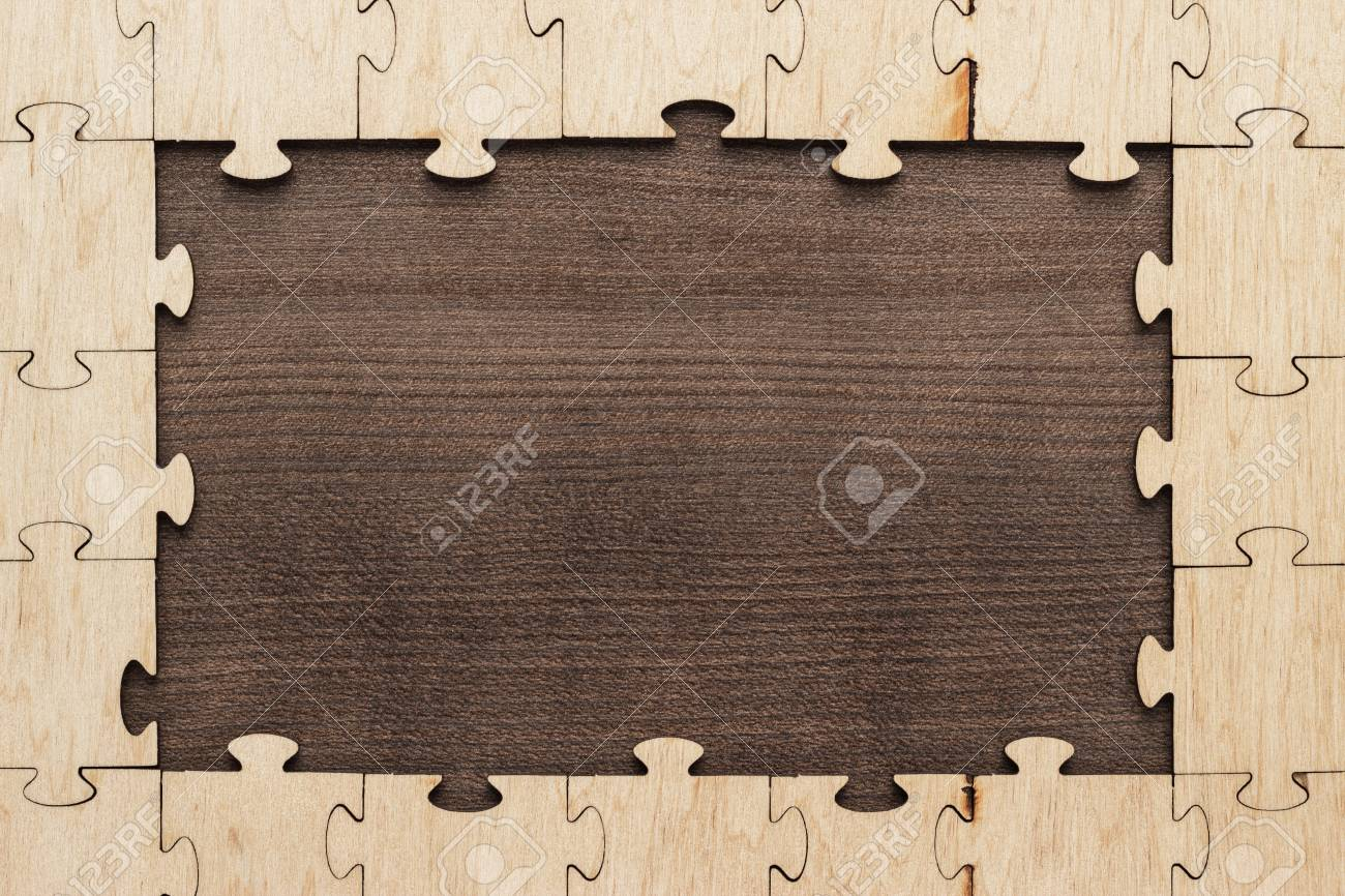 Frame Of Puzzle Pieces On Brown Wooden Table Stock Photo Picture