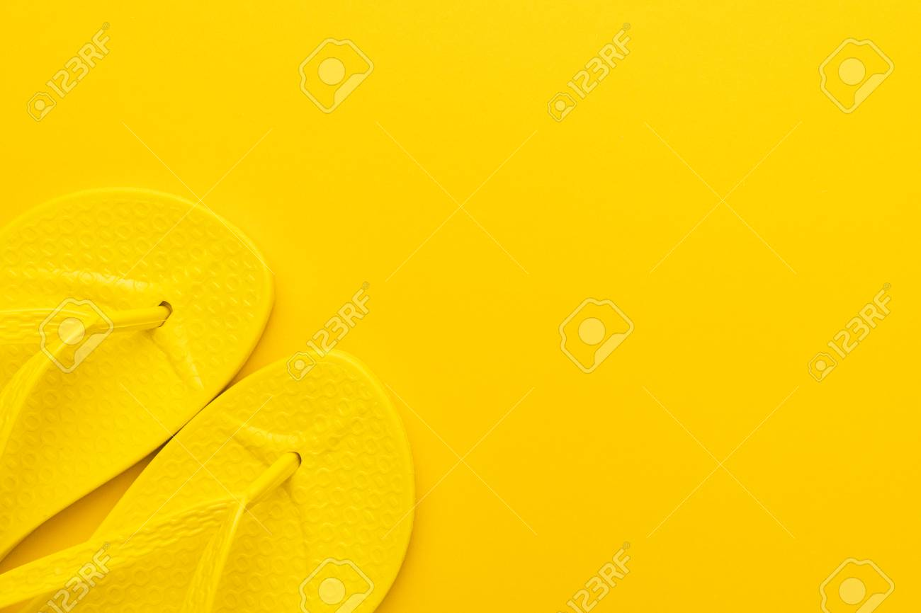 6b0e8b712457 beach flip-flops on the yellow background with copy space. summer concept  Stock Photo