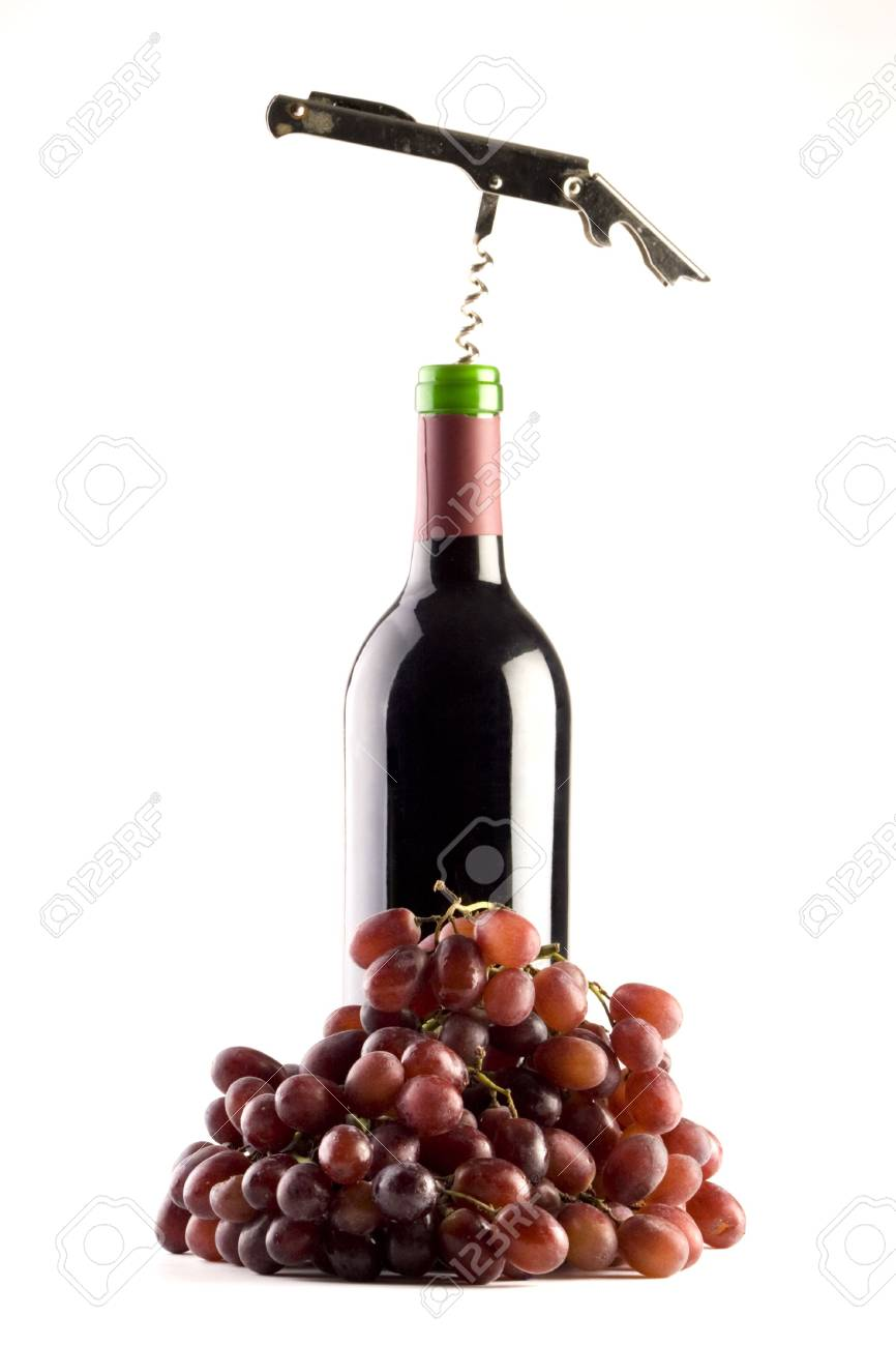 A Bottle of red wine with a corkscrew and grapes on a plain background Stock Photo - 2038386