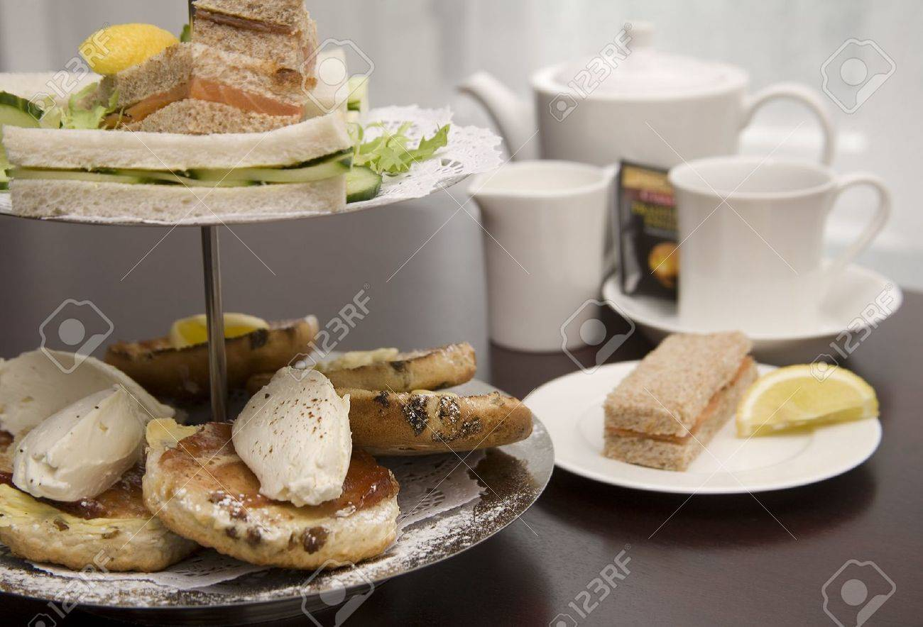 An arrangement of sandwiches and scones for afternoon tea Stock Photo - 3398056