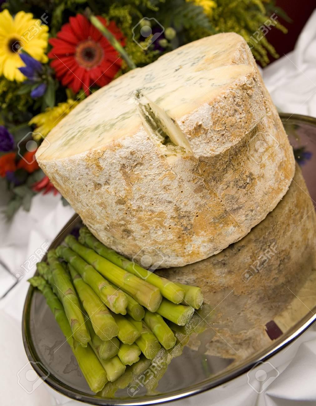 A whole Stilton cheese with asparagus spears. Stock Photo - 6080986