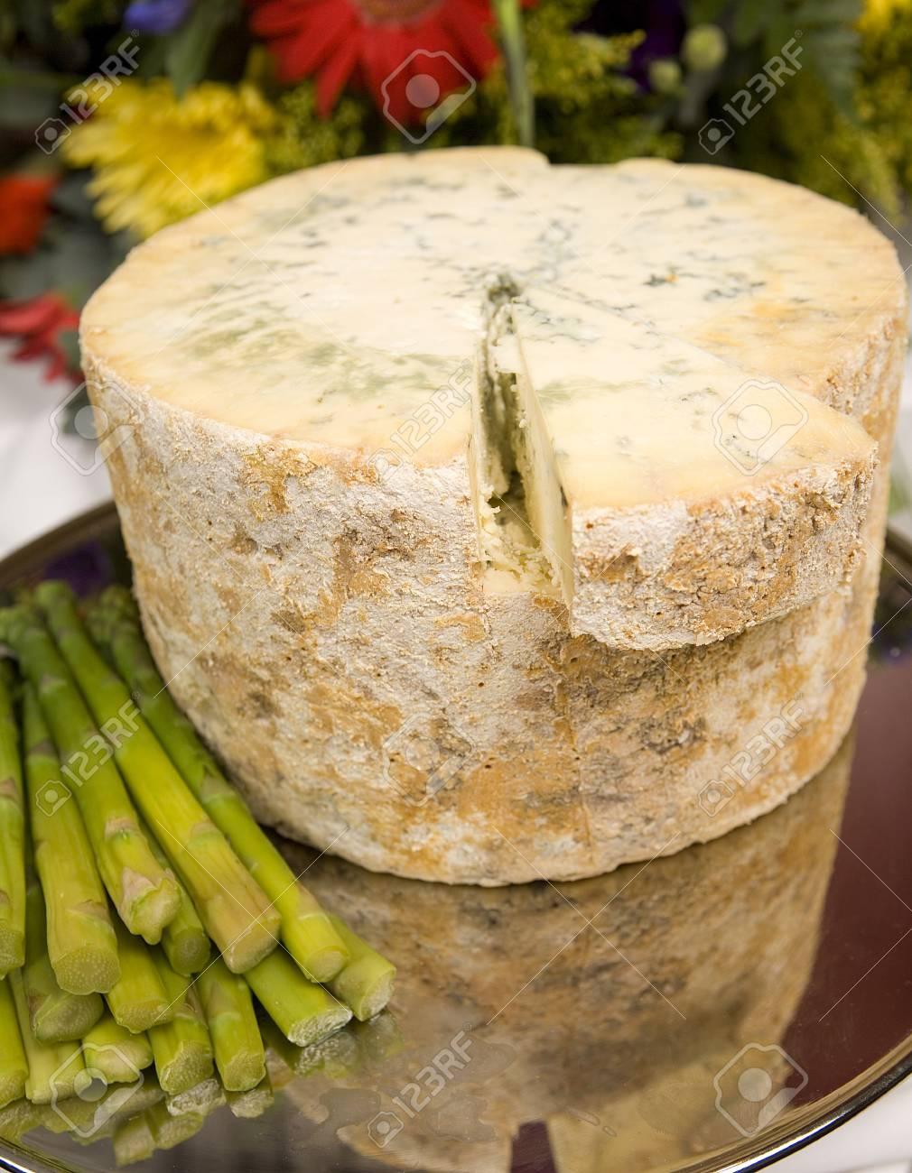 A whole Stilton cheese with asparagus spears. Stock Photo - 6080987