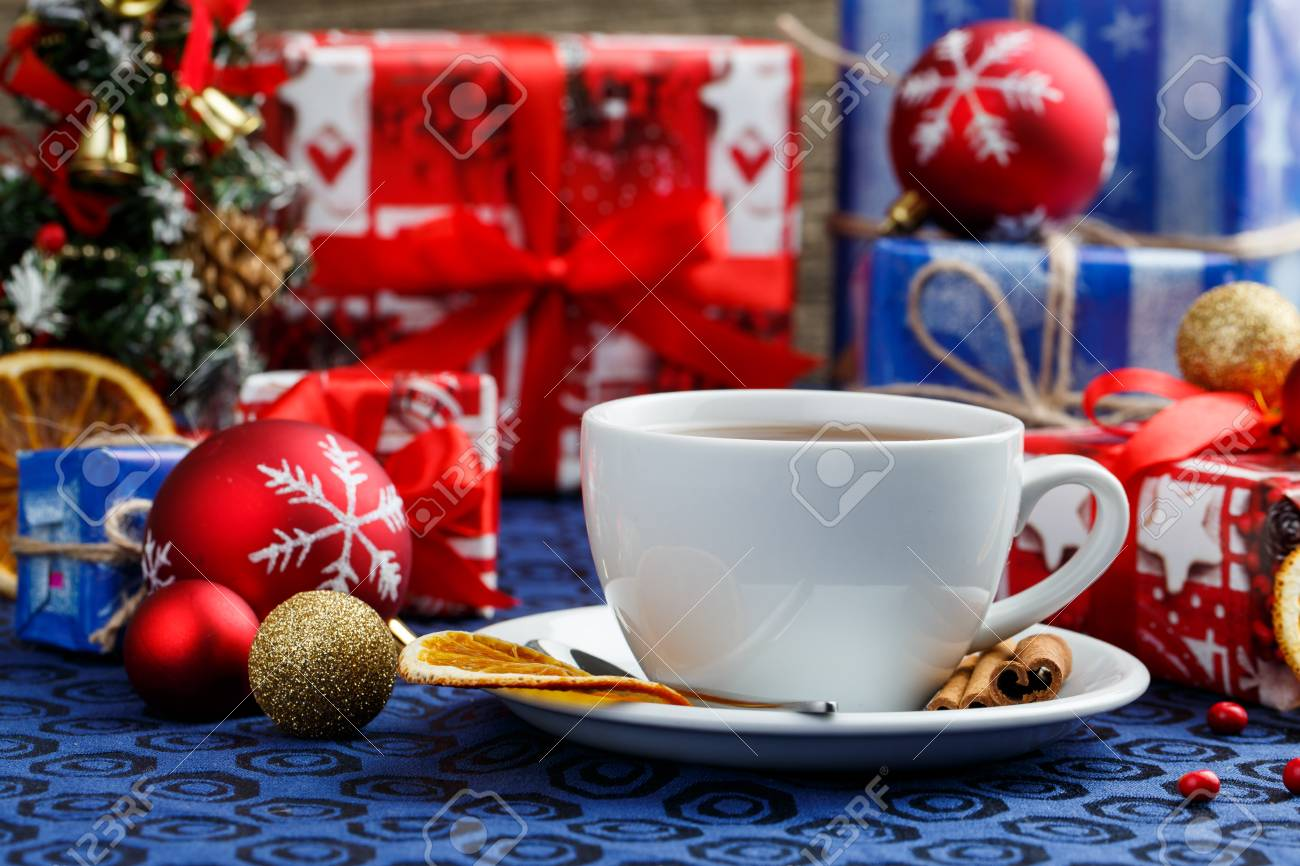 Tea Cup And Christmas Gifts On Table. Stock Photo, Picture And ...