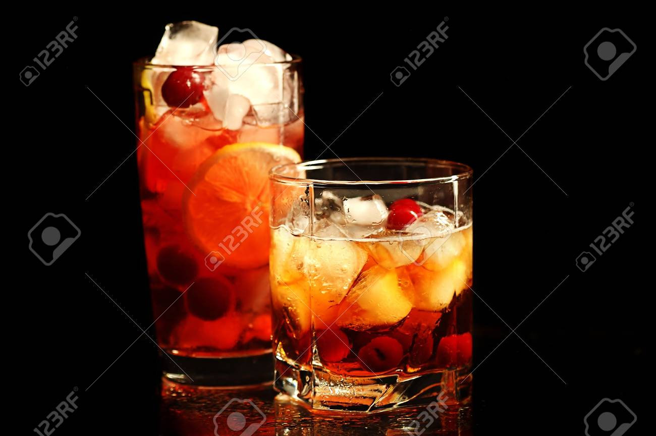 Freshening drink with ice and a lemon in a glass on a black background Stock Photo - 6447981