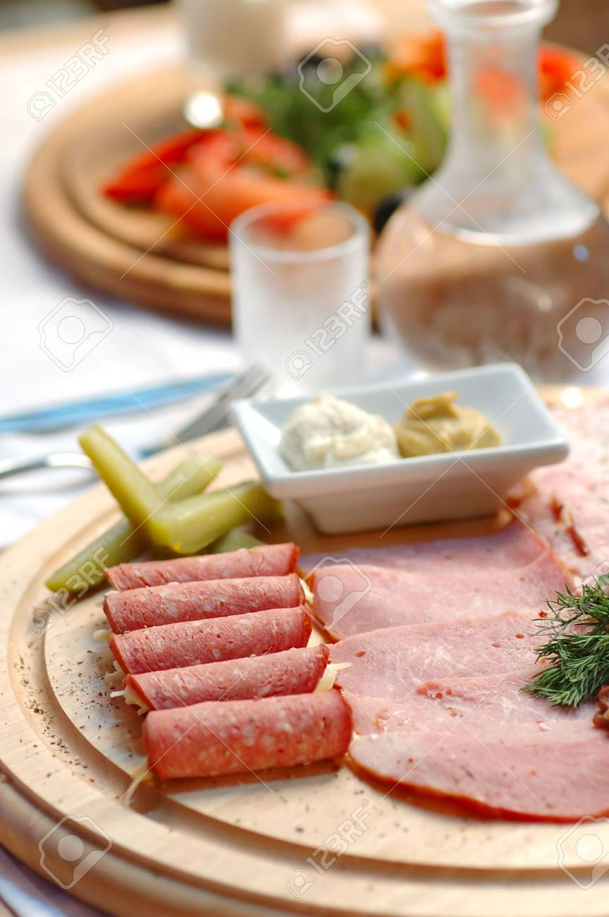 Snack from vegetables and meat on a dining table Stock Photo - 6689768