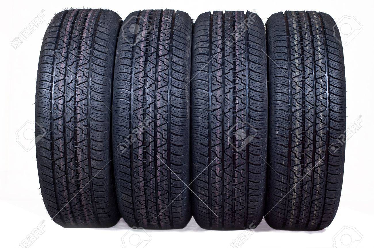 The complete set of new tyres for the car on a white background Stock Photo - 10552506