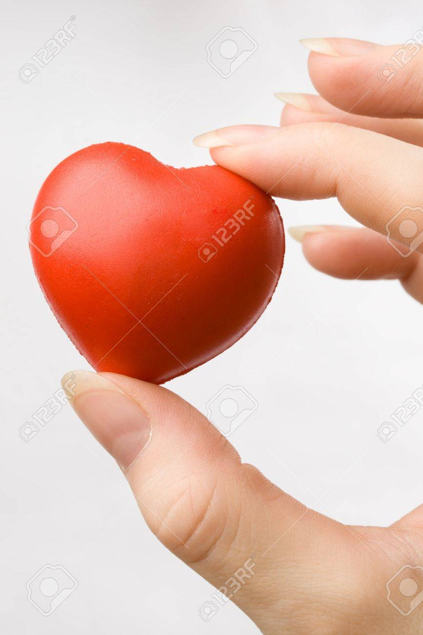 Female hand with red heart Stock Photo - 8625373