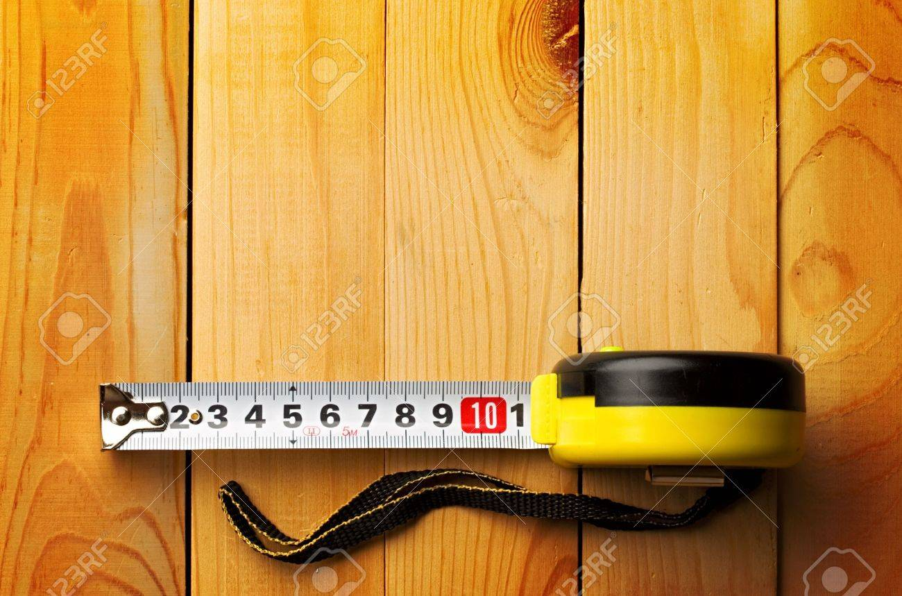 Tape measure isolated on wooden background Stock Photo - 8974015