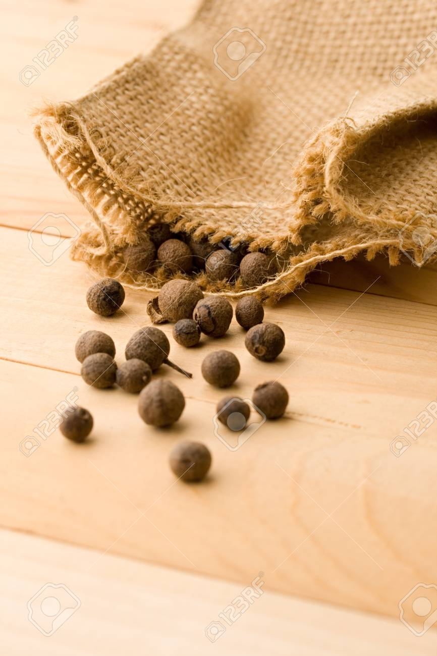 Pepper isolated on wooden background Stock Photo - 8986681