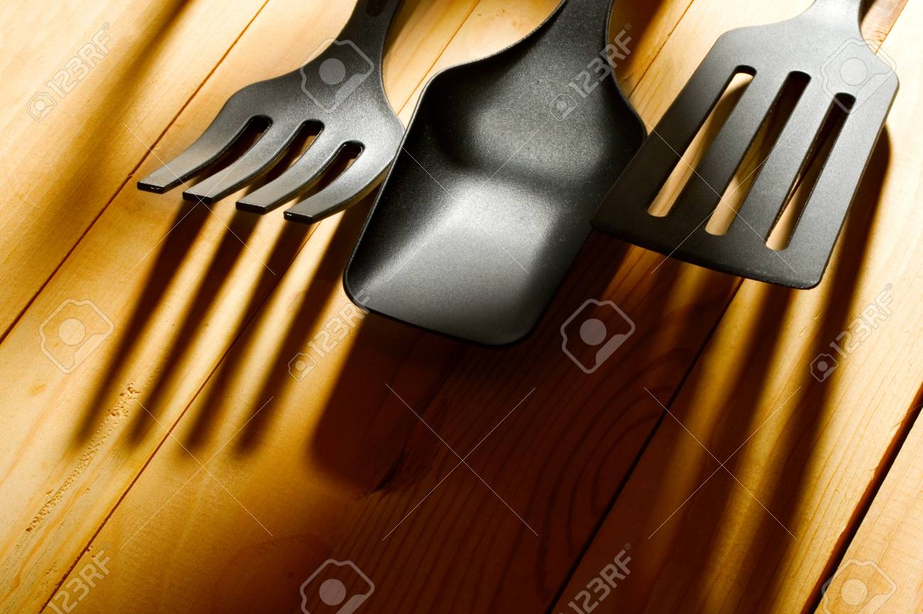 Kitchen utensil collection isolated on wooden background Stock Photo - 10831409