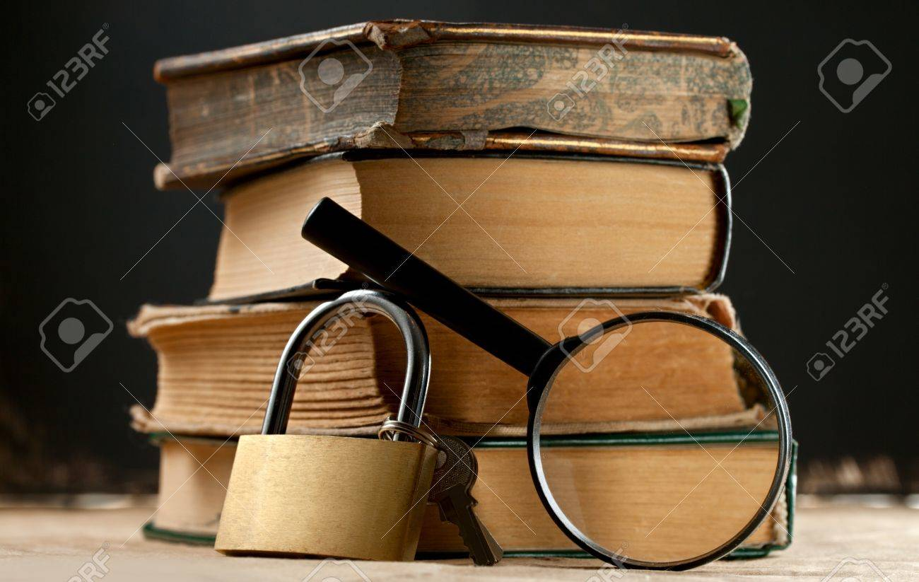 Old books with keylock and magnifying glass Stock Photo - 12752856