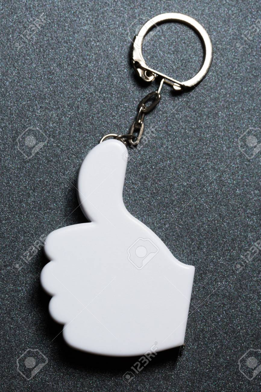 Okay sign badge on metal key ring Stock Photo - 14810656