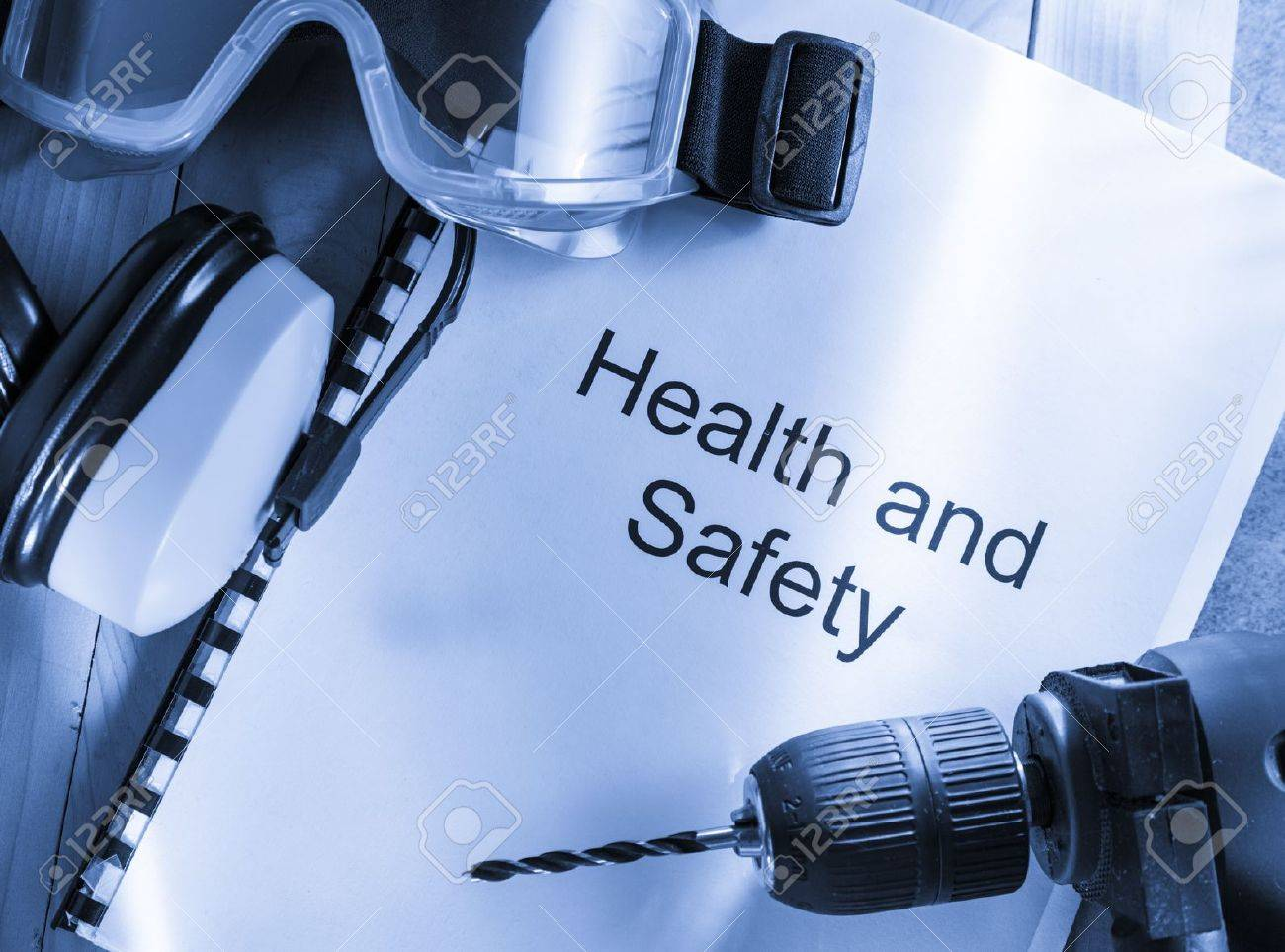 Health and safety Register with goggles, drill and earphones Stock Photo - 15495495