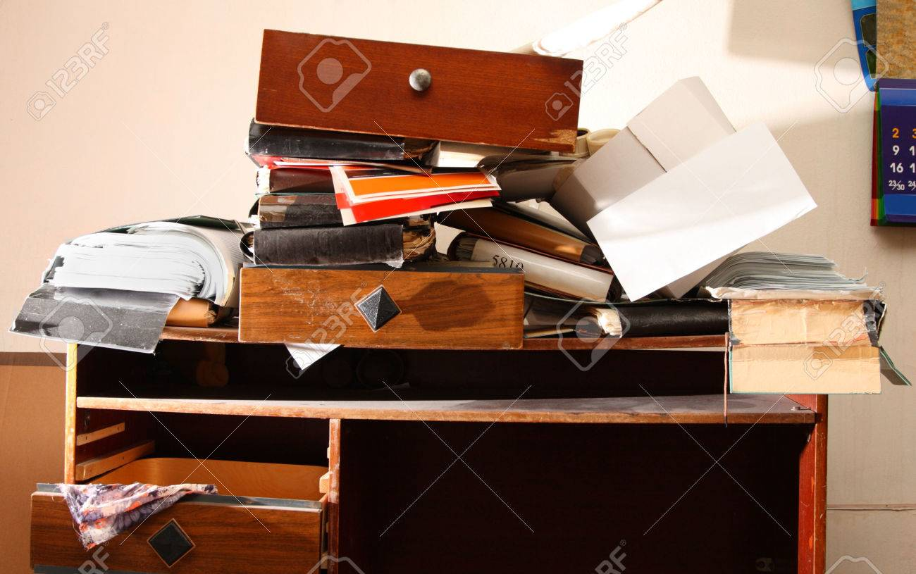Messy workplace with stack of paper Stock Photo - 23846284