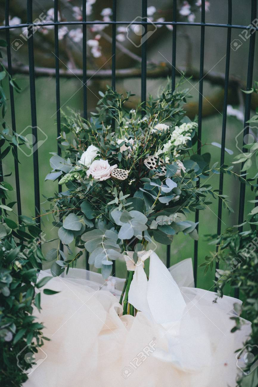 Wedding Bouquet Of Simple White Flowers And Green Leaves In Vintage