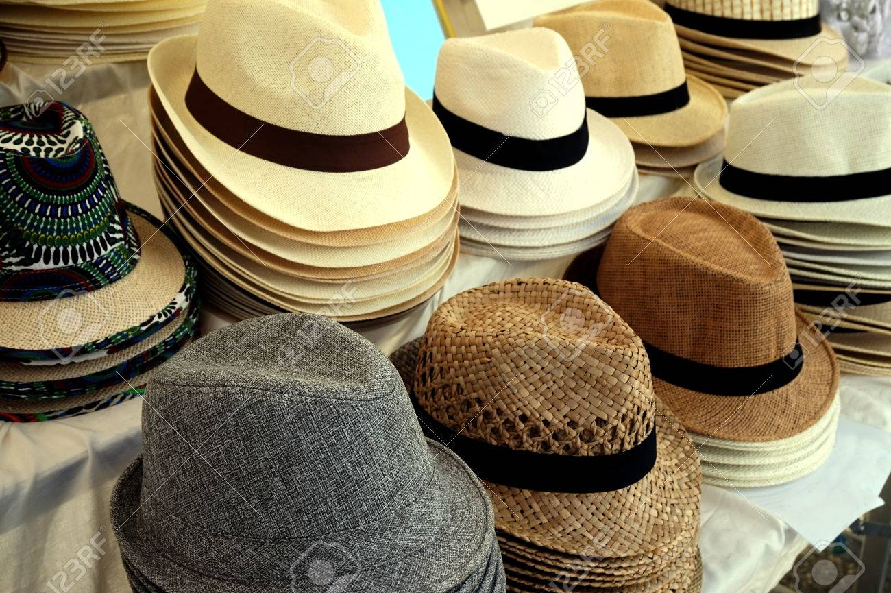 0477637d05765 Straw fedora hats for men in varied colors and designs on a market stall  Stock Photo