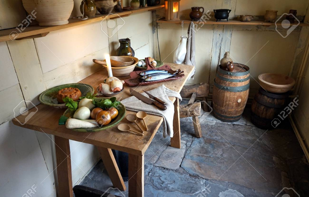 Rustic Old Wooden Dining Table In A Medieval Cottage Laid With