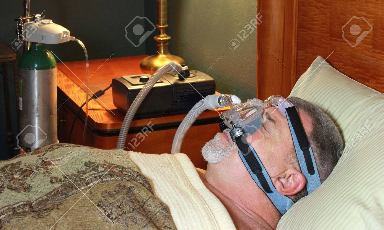 Adult Man Sleeping Peacefully with CPAP and Oxygen Stock Photo - 17424994