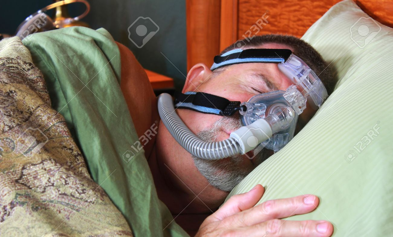 Adult Man Sleeping Peacefully with CPAP Mask Stock Photo - 17424991