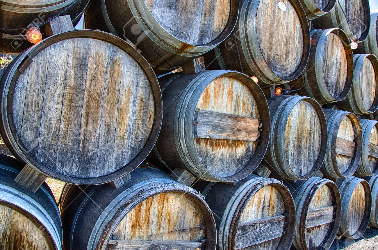 stacked oak wine barrels. Rustic Oak Wine Barrels Stacked At A California Winery. Stock Photo - 31812710 Y