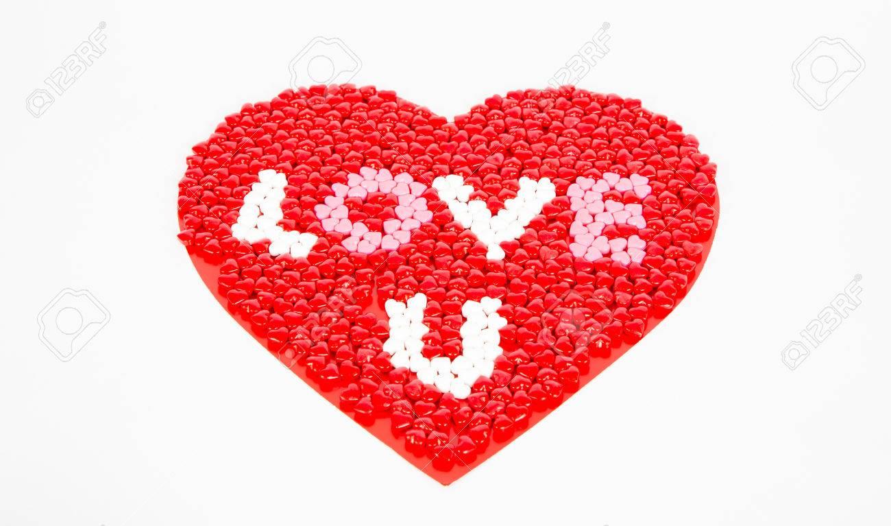 Rojo Corazones De Caramelo Blanco Y Rosa Para El Día De San Valentín Arrainged En Un Gran Corazón En Un Fondo Blanco Pizca De La Frase Aman U