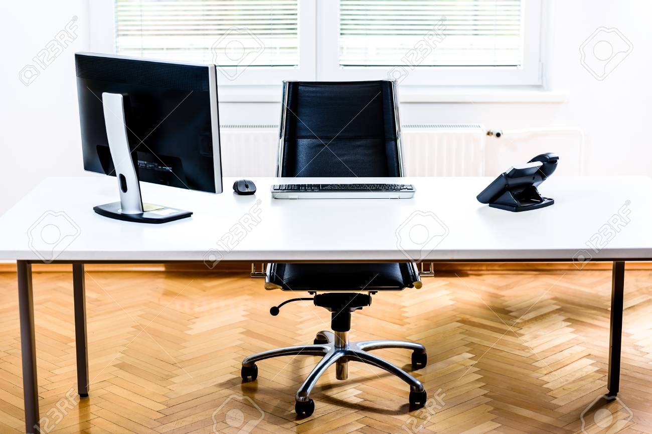 Modern Empty Office Space Desk With Computer Phone And Chair Stock Photo Picture And Royalty Free Image Image 68722361