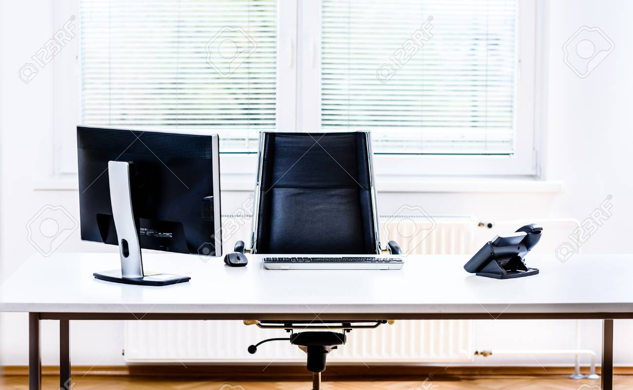 Modern Empty Office Space Desk With Computer Phone And Chair Stock Photo Picture And Royalty Free Image Image 68723865