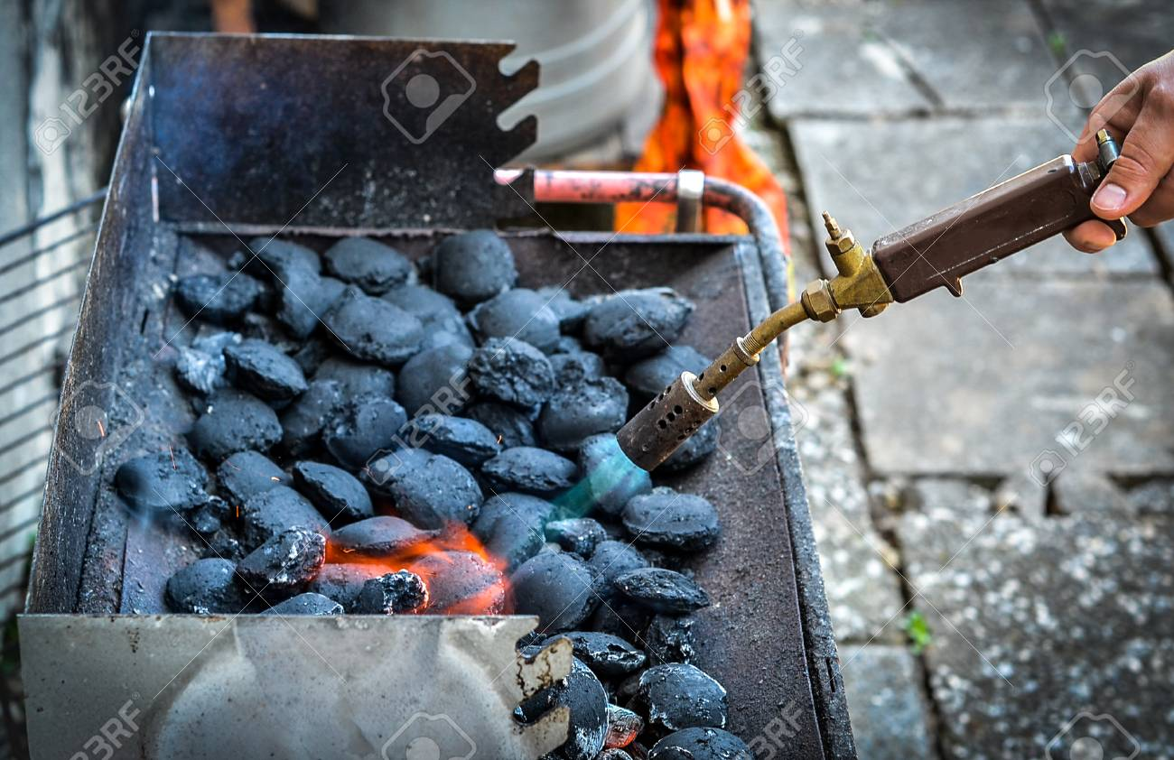Firing Up Charcoal Briquettes For The Bbq Grill Starting A Grill Stock Photo Picture And Royalty Free Image Image 68914740