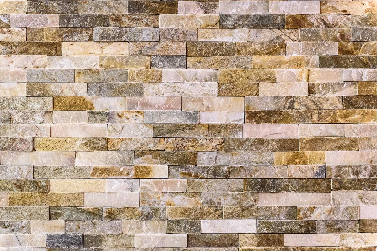 Modern Pattern Of Decorative Natural Stone Wall Surface Texture Pattern.  Rock Stone Brick Tile Wall