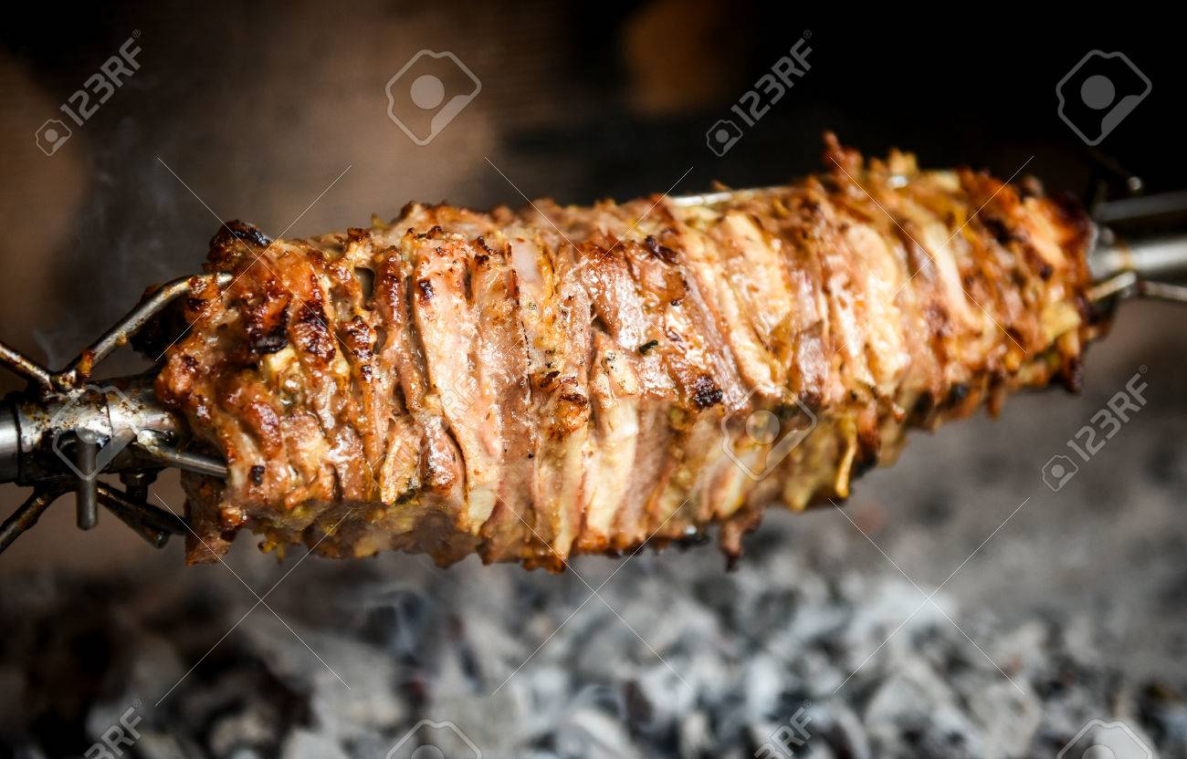 https www 123rf com photo 74990988 making home made cag kebab gyros with fire and charcoal ca c4 9f or d c3 b6ner kebab c4 b1 is pieces of meat on a b html