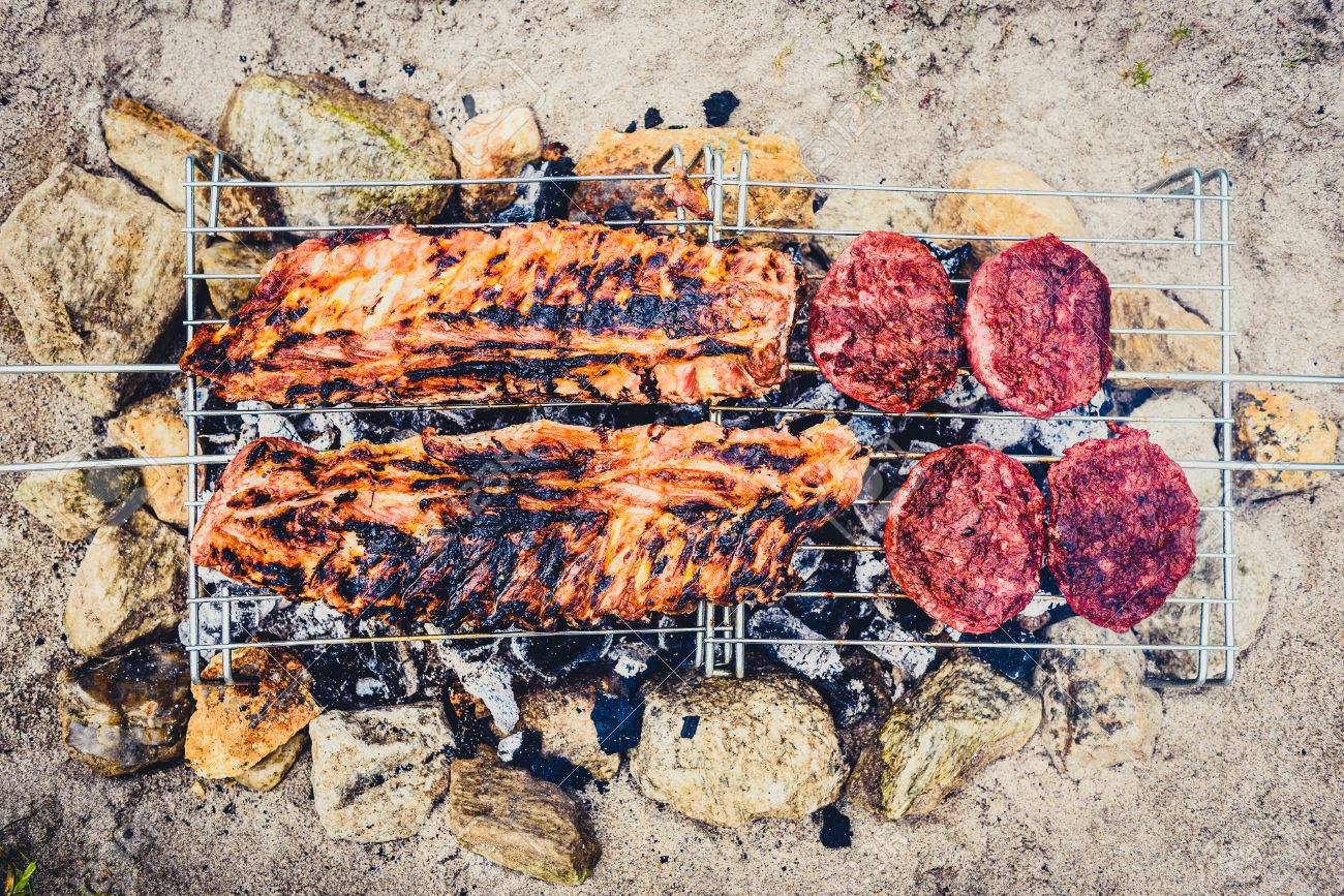 Pork Ribs And Burgers On Homemade Improvised Bbq Barbecue Grill Stock Photo Picture And Royalty Free Image Image 82877424
