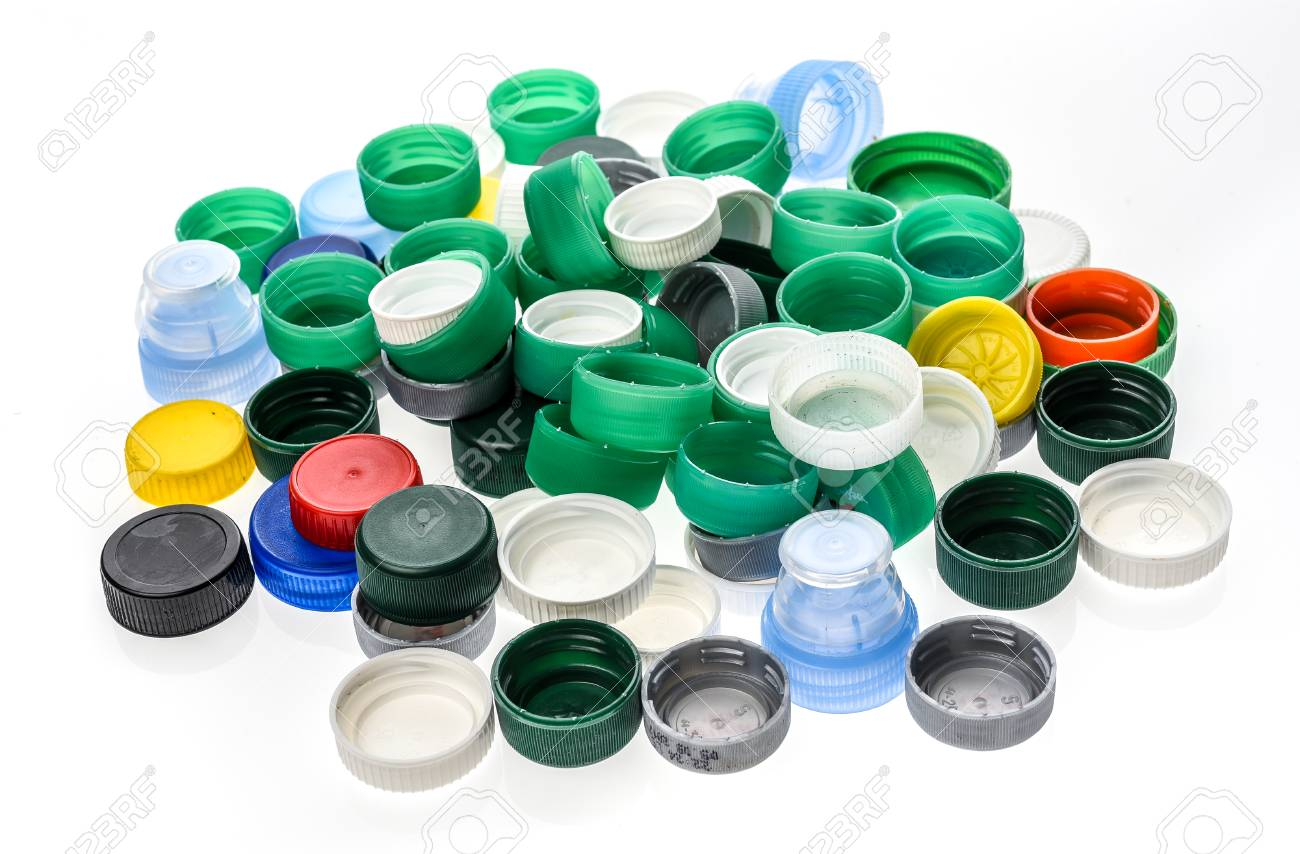 Plastic bottle caps in different colours  A pile of plastic bottle