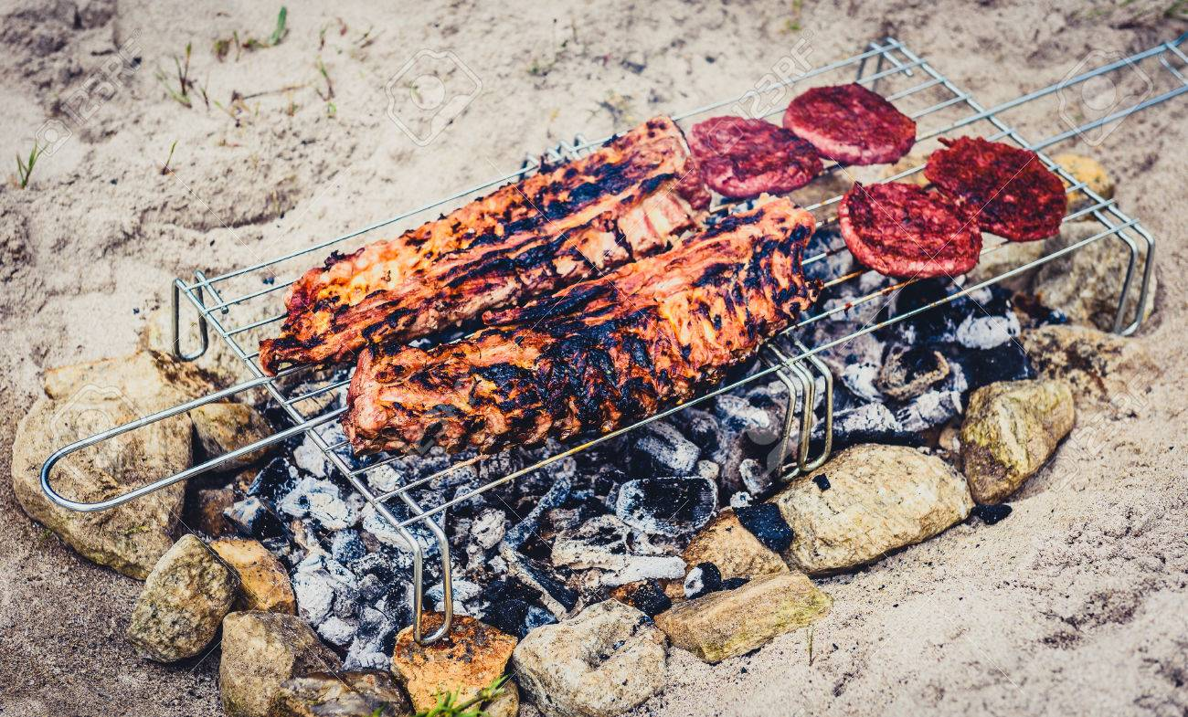 Pork Ribs And Burgers On Homemade Improvised Bbq Barbecue Grill Stock Photo Picture And Royalty Free Image Image 83219200