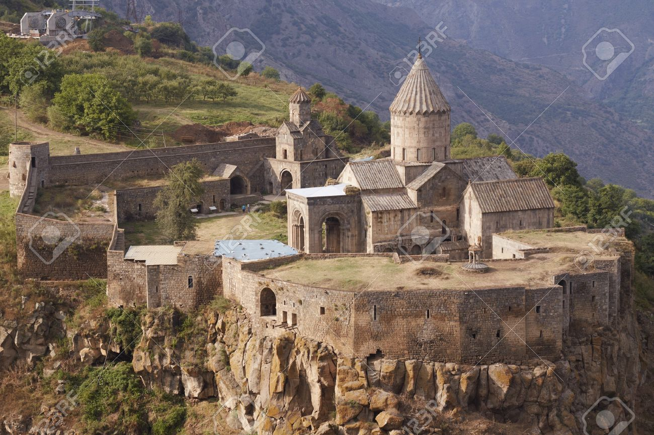 the Tatev monastery, Armenia, about IX century, big building is church of st. Poghos and Petros, about X century, monastery is above the river Vorotans canyon, in thick walls is monks cells and another rooms, unfinished ropeway station in the distance Stock Photo - 7733943