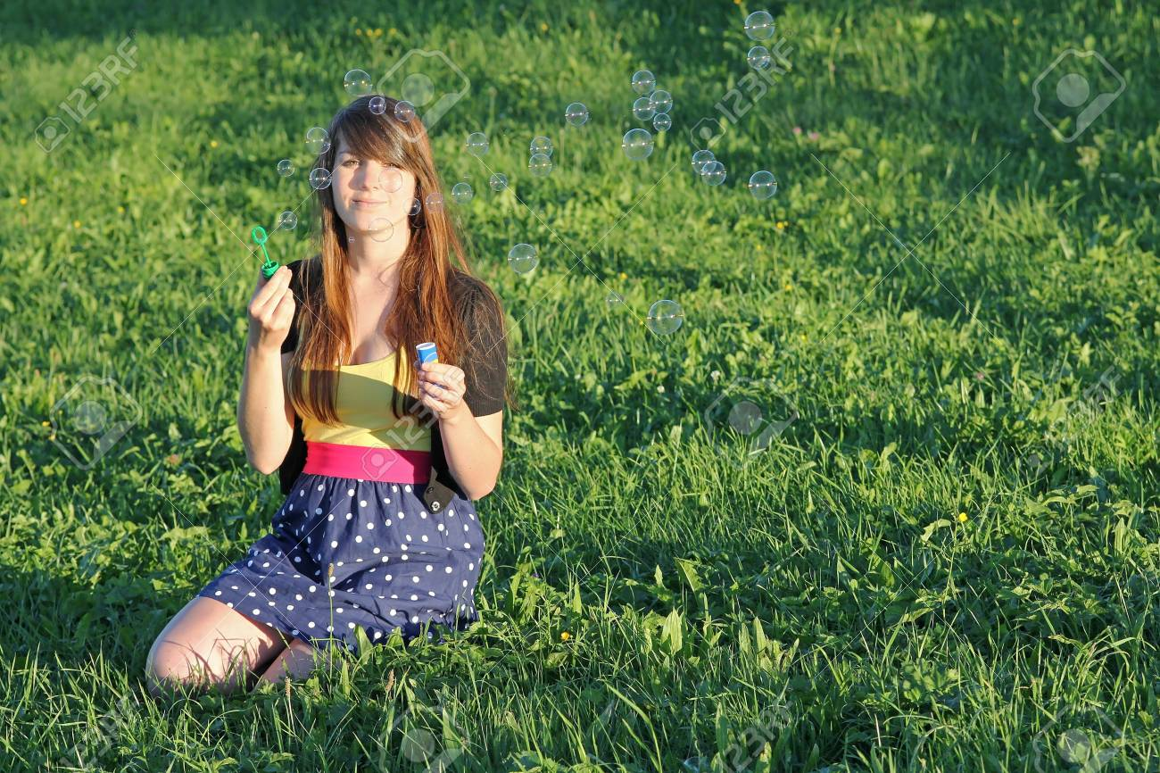 A young girl blowing soap bubbles Stock Photo - 16846045