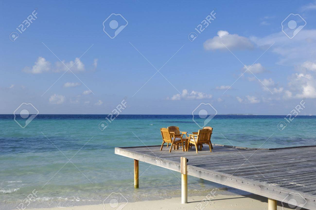 Chairs and table on deck by beach, Kuramathi island, Maldives Stock Photo - 3090854