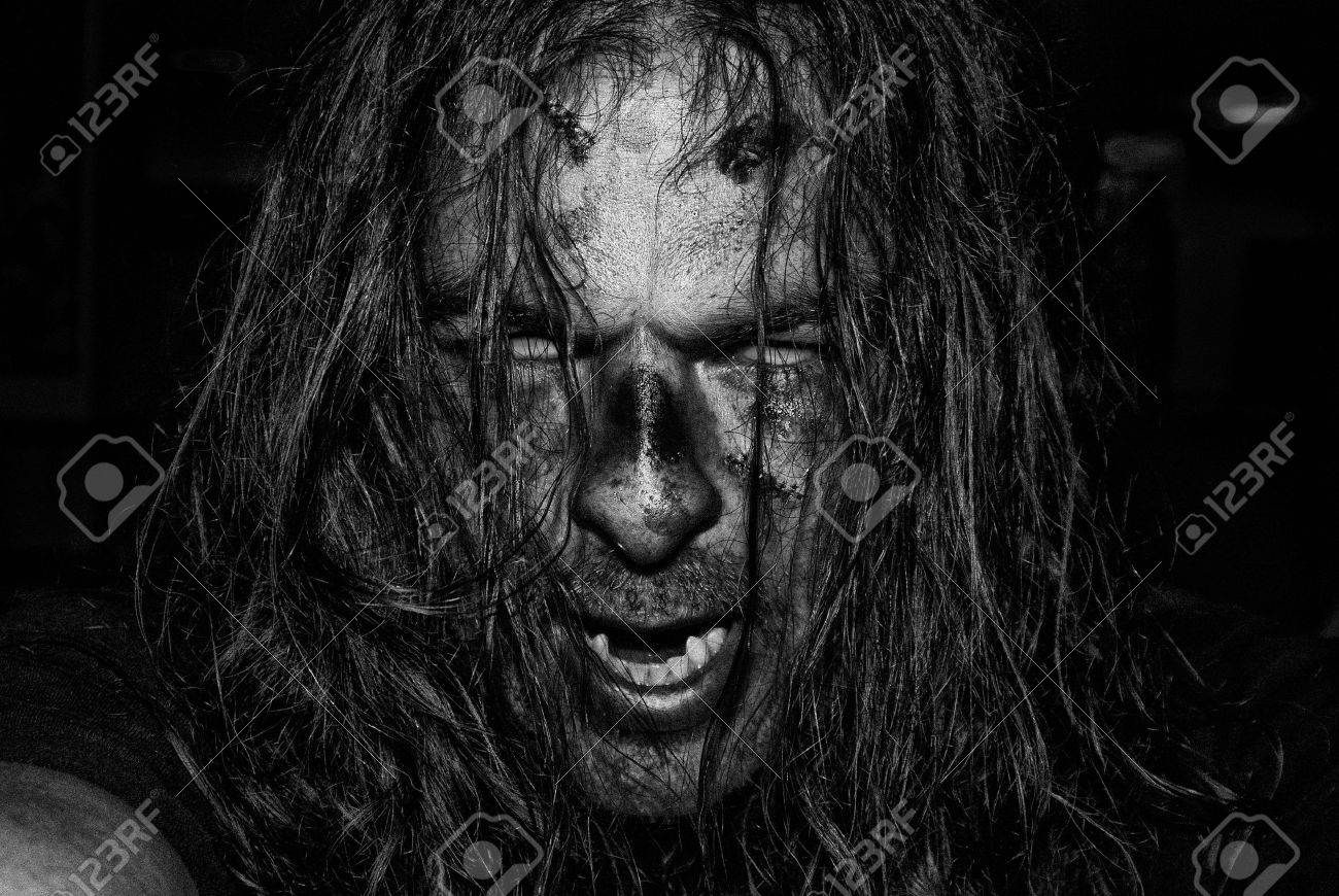 Stock photo the face of an evil male zombie in high contrast black and white