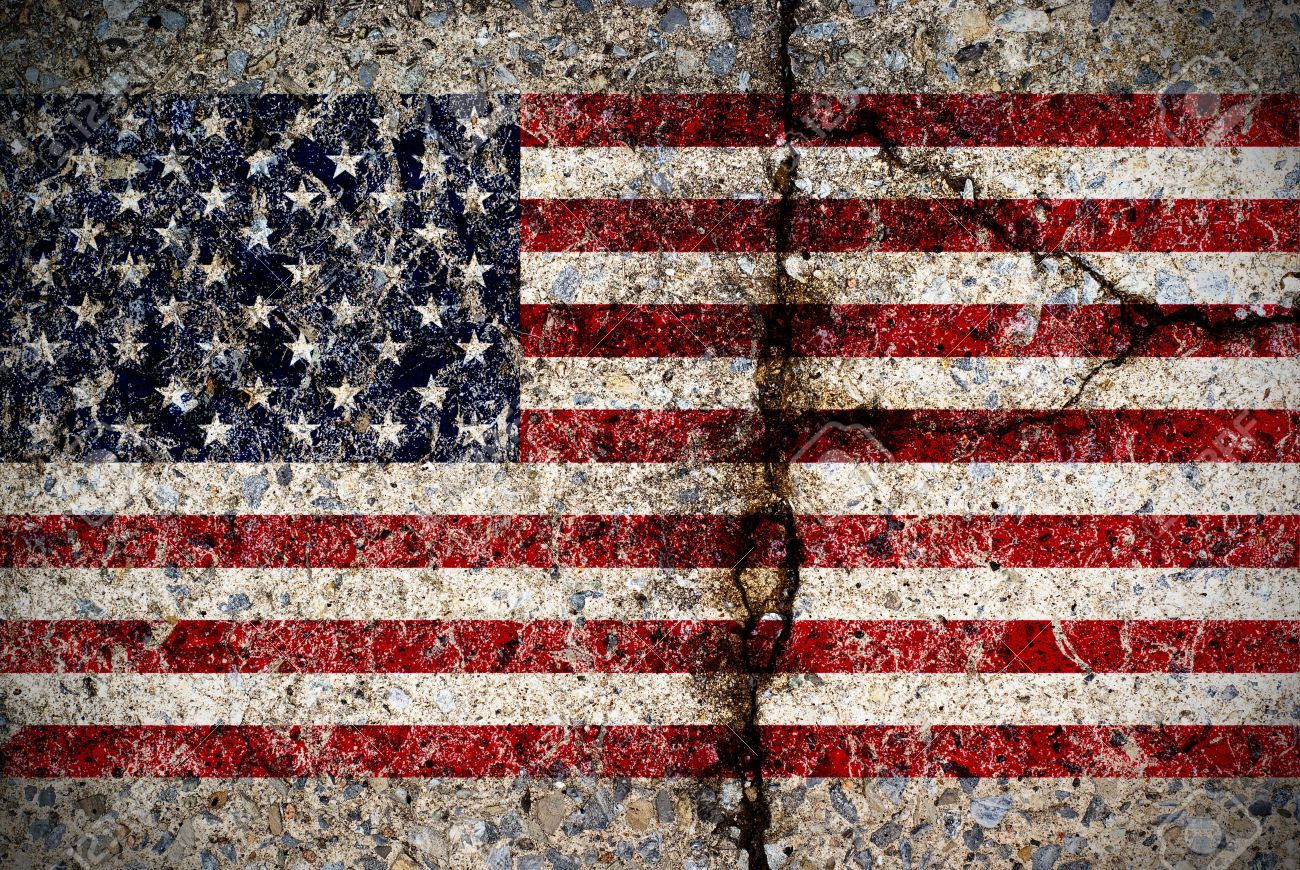 A worn and fading American flag painted on a cracked concrete surface. - 7158473
