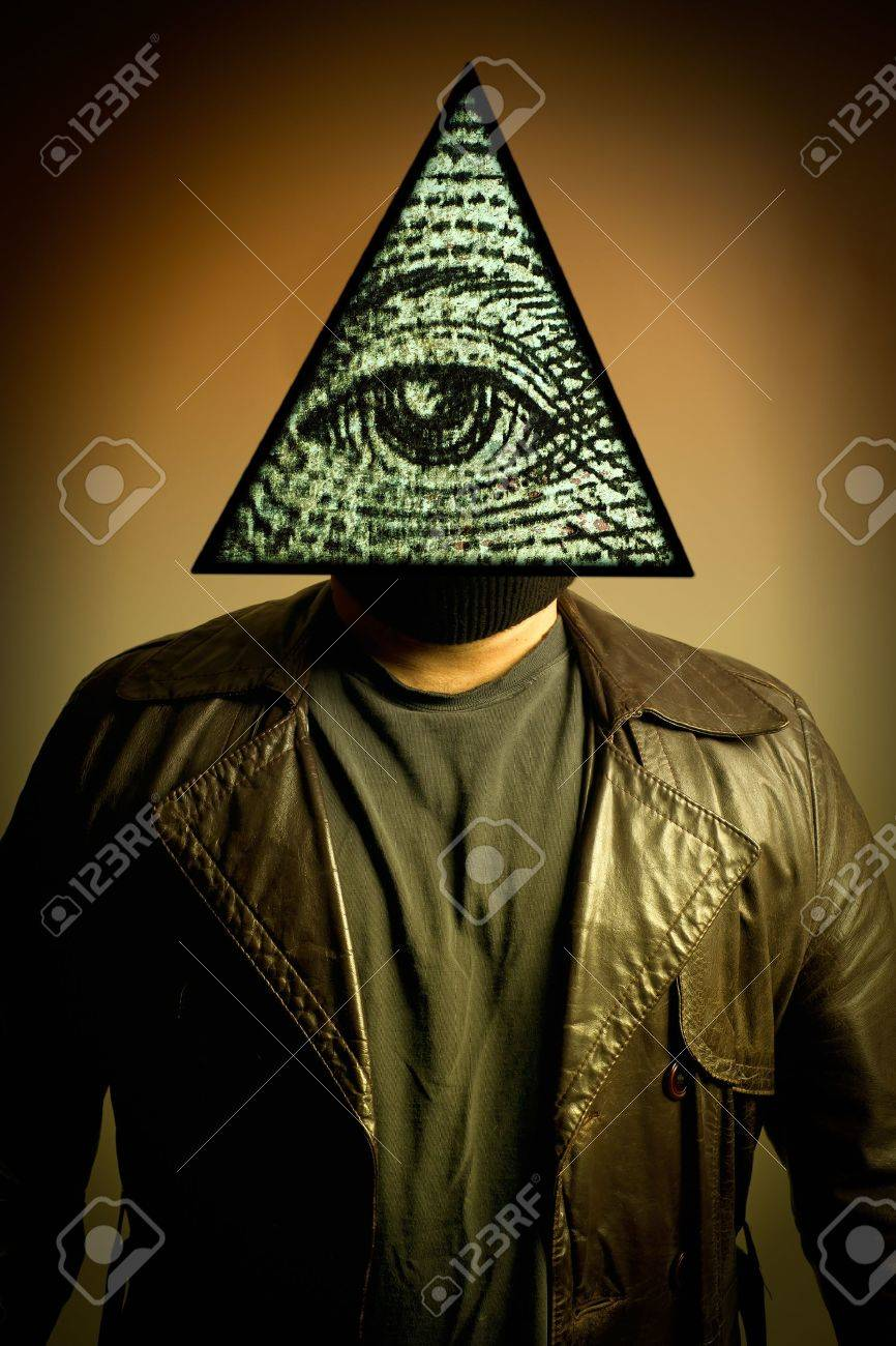A male figure in a leather trench coat wearing an illuminati symbol eye of providence, or all seeing eye mask. Stock Photo - 10412109