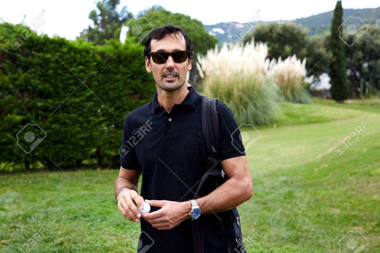 443bb1b01a Portrait of handsome rich man in glasses having good leisure time during  golf game, golfer