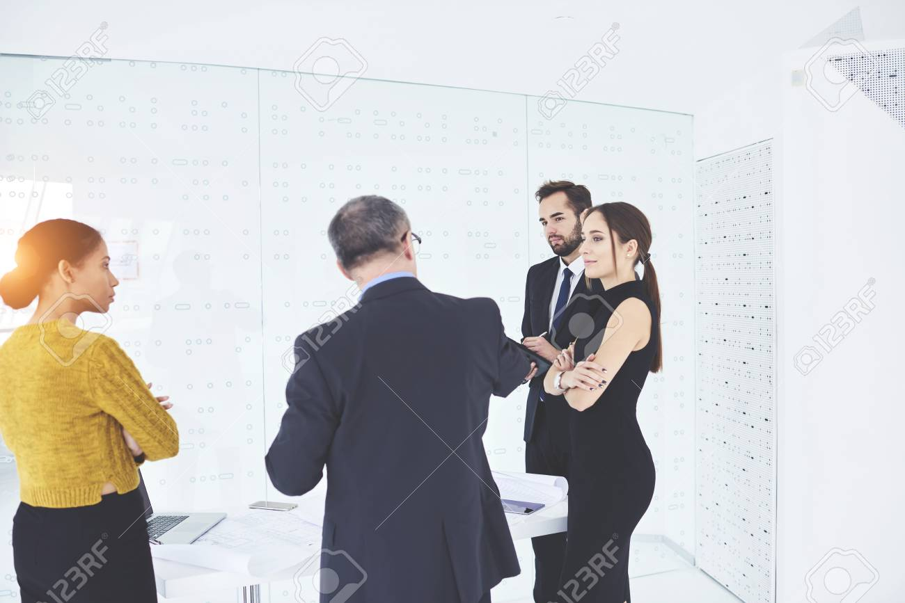 Talented Male And Female Journalists Having Conversation With Experienced Male Entrepreneur Making Interviews Asking Questions About