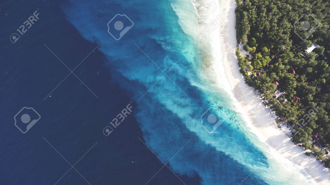 top view aerial drone photo of stunning colored sea beach with