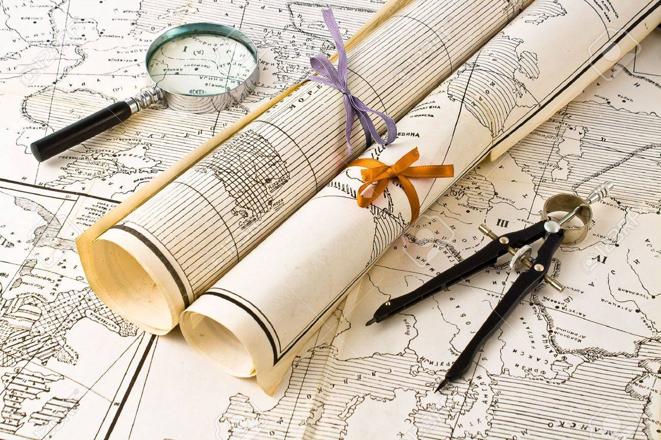 Old Maps in rolls with magnifier and compass Stock Photo - 9988907