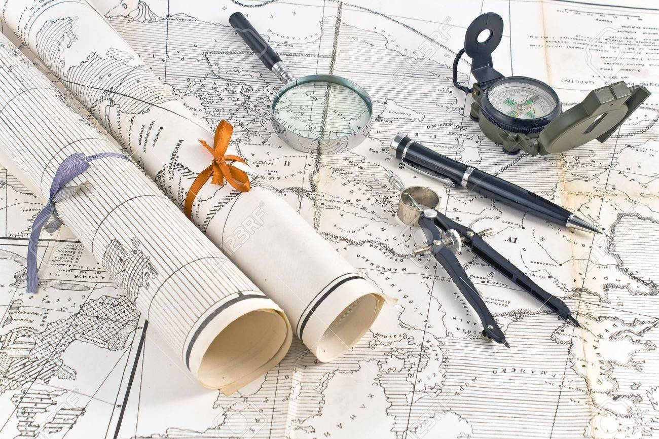 Old Maps in rolls with magnifier and compass Stock Photo - 17696083