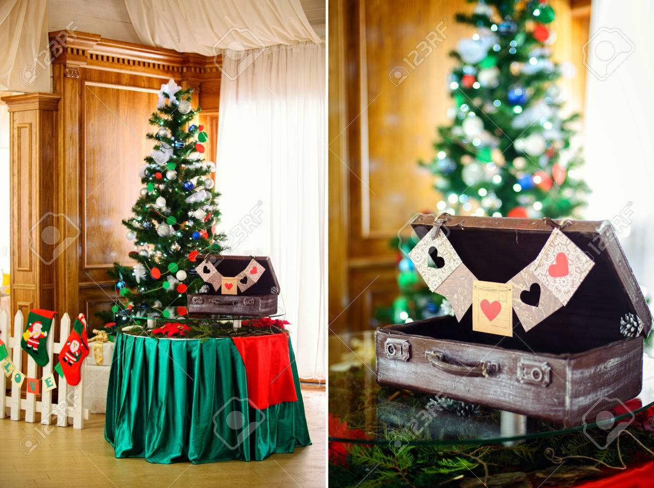 Christmas decorations christmas tree and suitcase on the table christmas decorations christmas tree and suitcase on the table for a winter wedding stock junglespirit Gallery