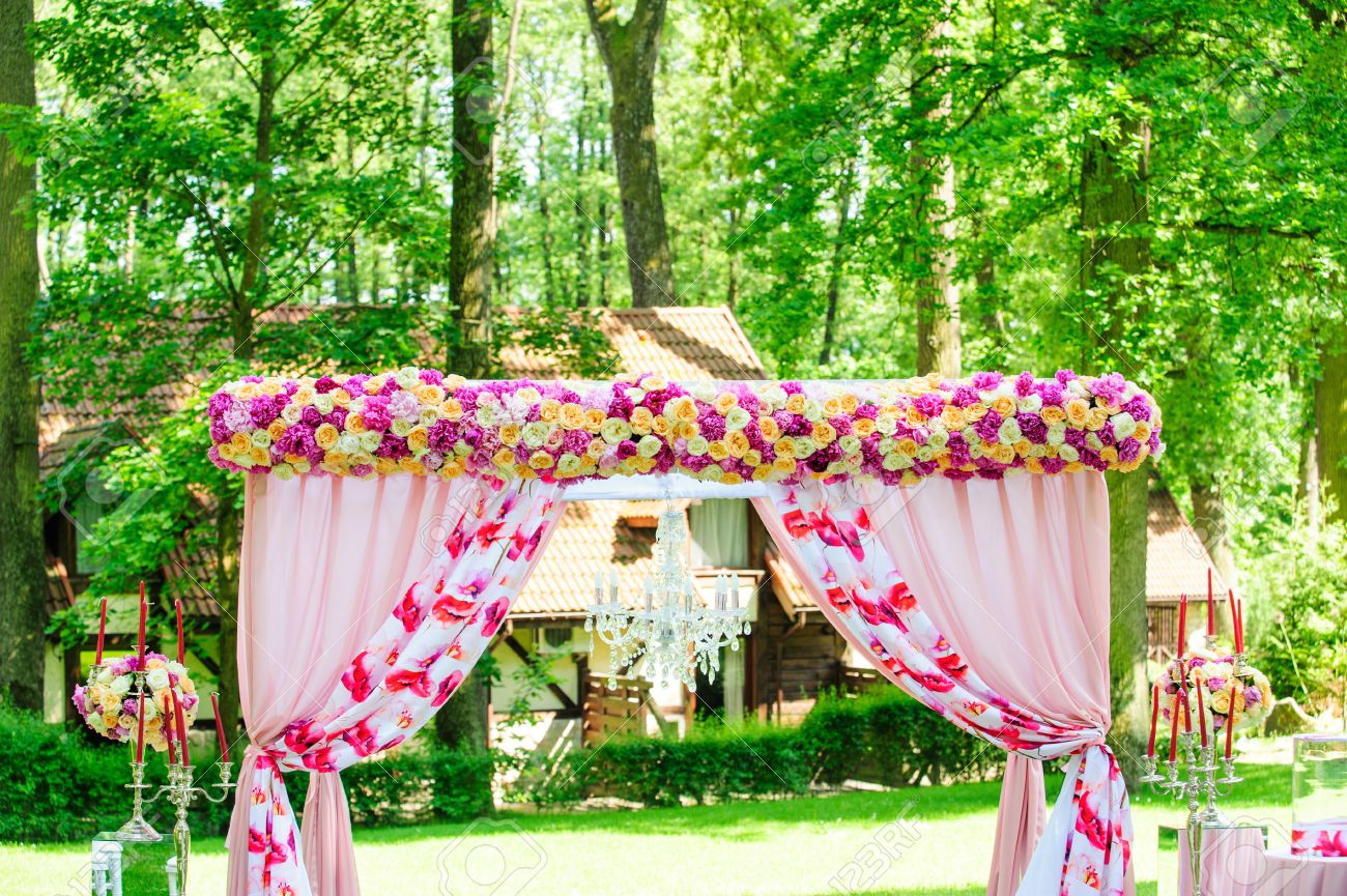 Pink Wedding Arc With Roses And Peonies Like Decoration For