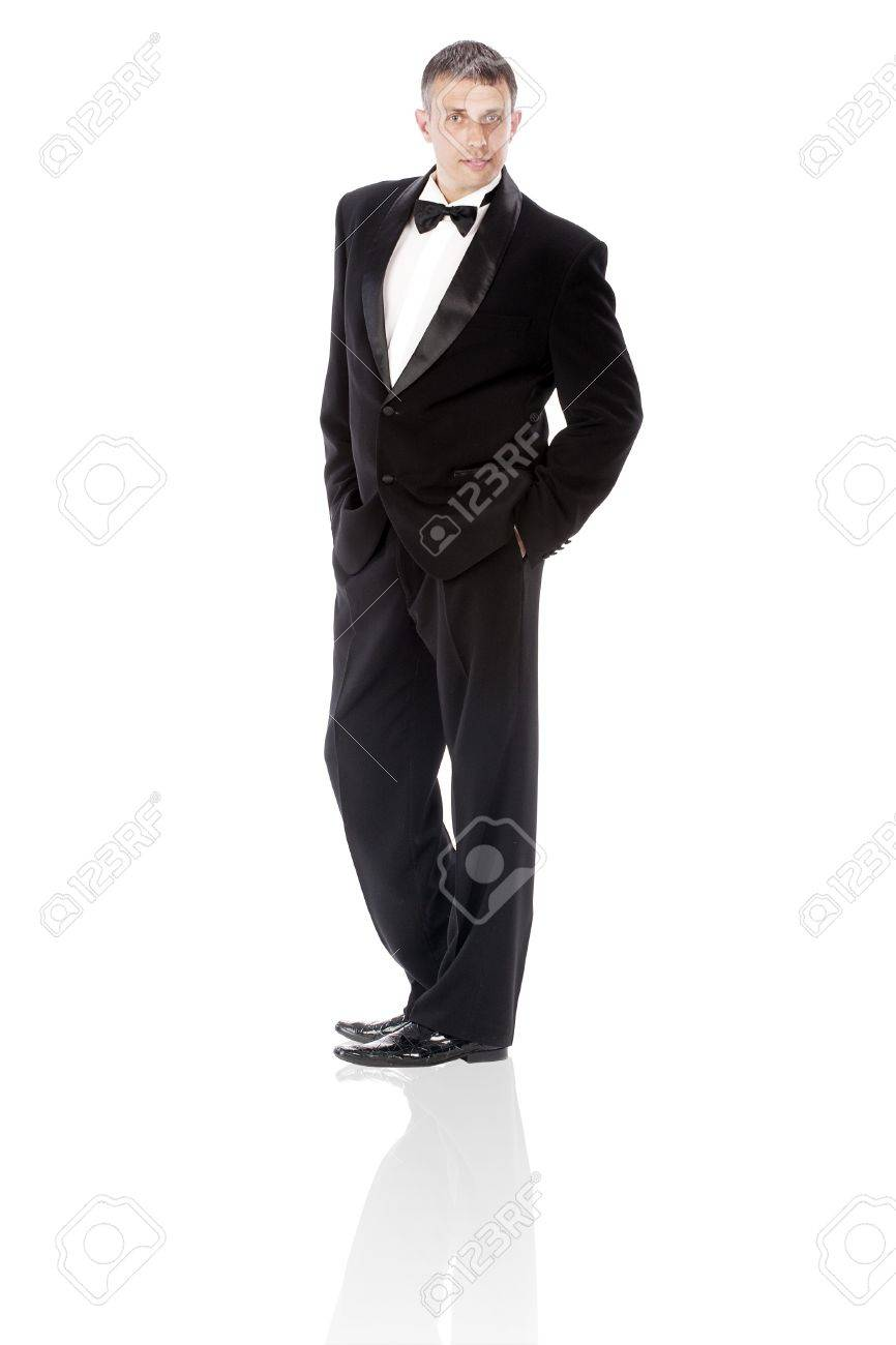 The elegant man in a classical tuxedo on a white background Stock Photo - 12861857